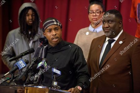 Stevante Clark, the brother of Stephon Clark who was killed by police last year, speaks during a news conference at the Genesis Church in Sacramento, Calif., . Accompanying Clark are his brother Jhailen Clark, left, National Action Network representative Margaret Fortune, and Tecoy Porter Sr., pastor at the Genesis Church. Clark's comments followed Saturday's announcement by Sacramento District Attorney Anne Marie Schubert that the two officers who shot and killed Stephon Clark will not be charged in the shooting
