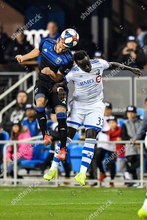 San Jose Earthquakes midfielder Valeri Qazaishvili (11) gets the header over Montreal Impact defender Bacary Sagna (33) during the MLS game between the Montreal Impact and the San Jose Earthquakes at Avaya Stadium in San Jose, California