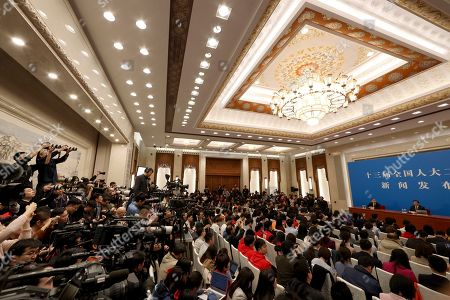 Zhang Yesui, right on stage, a spokesman for the National People's Congress, speaks during a press conference on the eve of the annual legislature opening session at the Great Hall of the People in Beijing on