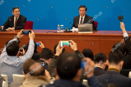 Zhang Yesui, right, a spokesman for the National People's Congress, speaks during a press conference on the eve of the annual legislature opening session at the Great Hall of the People in Beijing on