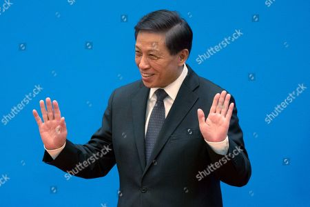 Zhang Yesui, a spokesman for the National People's Congress, arrives for a press conference on the eve of the annual legislature opening session at the Great Hall of the People in Beijing on