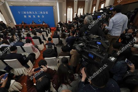Zhang Yesui, a spokesman for the National People's Congress, speaks during a press conference on the eve of the annual legislature opening session at the Great Hall of the People in Beijing on
