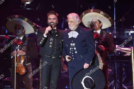 Tenor Placido Domingo (R) performs with Mexican singer Alejandro Fernandez (L) during a concert in Guadalajara, Mexico, 03 March 2019. Placido Domingo united opera and pop music singers, dancers and the Philharmonic Orchestra of the State of Jalisco (western Mexico) in a charity event for the Real Madrid Foundation. Around 10,000 people attended the 'Placido en el alma' concert, in homage to the opera singer, producer and Spanish conductor, at the Estadio 3 de Marzo in Zapopan.