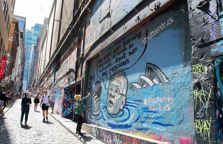 A view of a mural depicting Australian Prime Minister Scott Morrison in a flooded Sydney harbour holding a lump of coal, in Hosier Lane in Melbourne, Victoria, Australia, 04 March 2019. The mural was painted by artist Van T Rudd, the nephew of former prime minister Kevin Rudd.