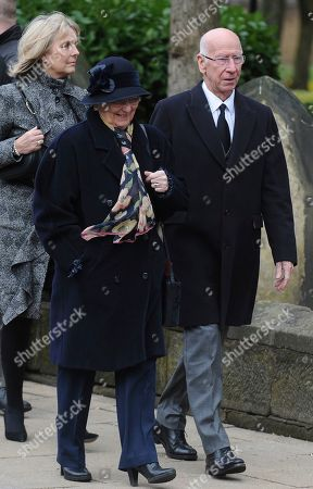 Former England footballer Bobby Charlton, right, arrive at the funeral service of former goalkeeper Gordon Banks at Stoke Minster, in Stoke on Trent, England,. Banks died on Feb. 12 aged 81