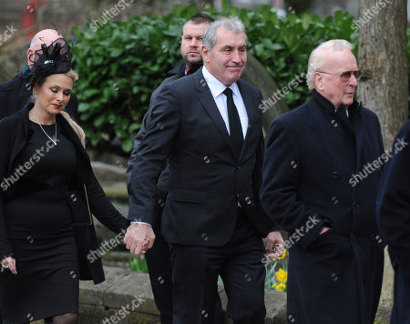 Former England goalkeeper Peter Shilton, centre, arrives for the funeral service of former goalkeeper Gordon Banks at Stoke Minster, in Stoke on Trent, England,. Banks died on Feb. 12 aged 81