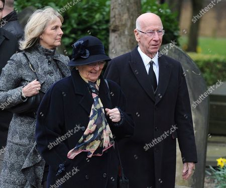 Former England footballer Bobby Charlton, right, arrives for the funeral service of former goalkeeper Gordon Banks at Stoke Minster, in Stoke on Trent, England,. Banks died on Feb. 12 aged 81