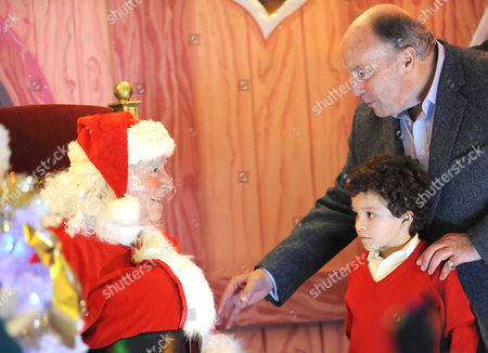 Ken Barlow, played by William Roache, dressed as Santa Claus with grandson Simon, played by Alex Bain, arrives with maternal grandfather George, played by Anthony Valentine.