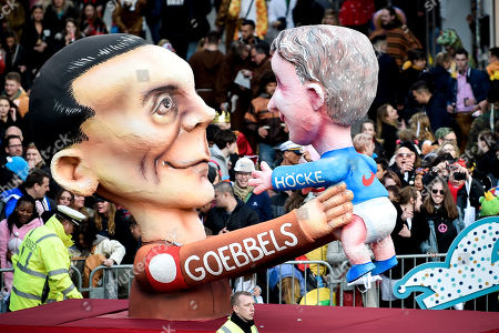 Stock Picture of A float depicting Thuringian AfD party and faction leader Bjoern Hoecke (R) and NS Propaganda Minister Joseph Goebbels (L)during the annual Rose Monday parade in Duesseldorf, Germany, 04 March 2019. Rose Monday is the traditional highlight of the carnival season in many German cities.