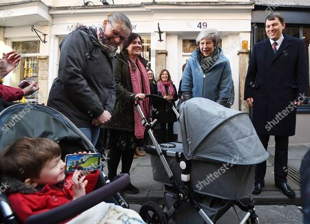 Britain's Prime Minister Theresa May (2-R) greets residents during a visit to Salisbury, Britain, 04 March 2019. May visited the historic city of Salisbury one year after the Novichok attack on former Russian spy Sergei Skripal and his daughter Yulia. Following initial investigation Prime Minister May told the House of Commons in mid-March 2018 that the nerve agent was of Russian origin and it was most likely that Russia being behind the attack. On right is Conservative MP John Glen, others are not identified.