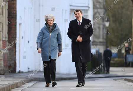 Britain's Prime Minister Theresa May (L) is accompanied by Conservative MP John Glen (R) as they walk to meet residents during a visit to Salisbury, Britain, 04 March 2019. May visited the historic city of Salisbury one year after the Novichok attack on former Russian spy Sergei Skripal and his daughter Yulia. Following initial investigation Prime Minister May told the House of Commons in mid-March 2018 that the nerve agent was of Russian origin and it was most likely that Russia being behind the attack.