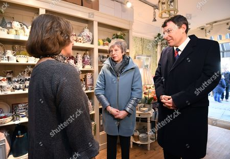 Britain's Prime Minister Theresa May (C) is accompanied by Conservative MP John Glen (R) as she speaks to Susi Mason (L), owner of the home interiors shop 'Casa Fina' during a visit to Salisbury, Britain, 04 March 2019. May visited the historic city of Salisbury one year after the Novichok attack on former Russian spy Sergei Skripal and his daughter Yulia. Following initial investigation Prime Minister May told the House of Commons in mid-March 2018 that the nerve agent was of Russian origin and it was most likely that Russia being behind the attack.