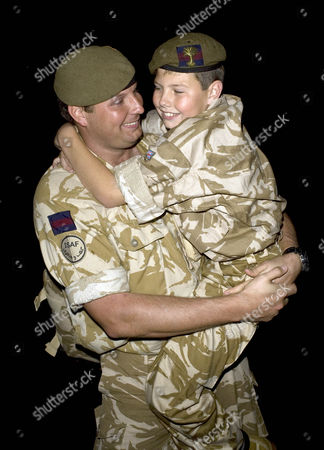 10-year-old Dylan Taylor from Cardiff with his father Company Sgt. Carl Taylor