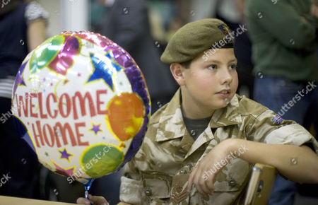 10-year-old Dylan Taylor awaits the return of his father Company Sgt.Carl Taylor