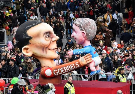 Stock Image of A carnival float depicts Nazi propaganda minister Joseph Goebbels holding AfD right-wing politician Bjoern Hoecke during the traditional carnival parade in Duesseldorf, Germany, on . The foolish street spectacles in the carnival centers of Duesseldorf, Mainz and Cologne, watched by hundreds of thousands of people, are the highlights in Germany's carnival season on Rosemonday