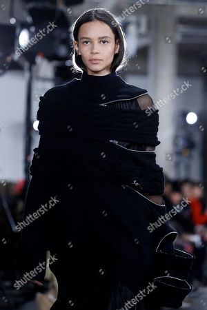 US model Binx Walton presents a creation from the Fall/Winter 2019/20 Women collection by Sacai fashion house during the Paris Fashion Week, in Paris, France, 04 March 2019. The presentation of the Women's collections runs from 25 February to 05 March.