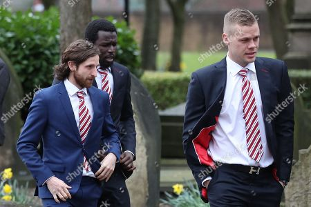Joe Allen, Mame Biram Diouf, Ryan Shawcross make their way into Stoke Minster prior to the funeral service of Gordon Banks