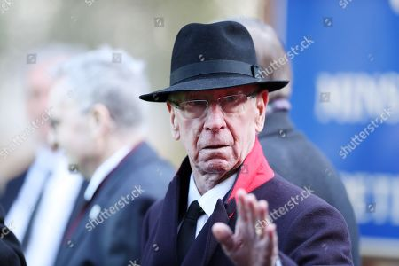 Sir Bobby Charlton waves to well wishes following the funeral of Gordon Banks at Stoke Minster