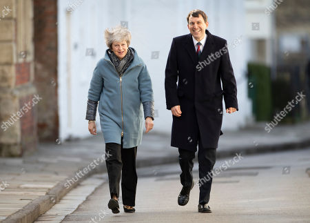 Stock Photo of Prime Minister Theresa May walks with John Glen MP during a visit to Salisbury on the first anniversary of the poisoning of former Russian spy Sergei Skripal and his daughter Yulia in March 2018. They both survived the nerve agent attack but a resident of nearby Amesbury, Dawn Sturgess, died in June 2018 after coming in contact with the poison. Two Russians have been named in connection with the attack.