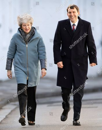 Stock Image of Prime Minister Theresa May walks with John Glen MP during a visit to Salisbury on the first anniversary of the poisoning of former Russian spy Sergei Skripal and his daughter Yulia in March 2018. They both survived the nerve agent attack but a resident of nearby Amesbury, Dawn Sturgess, died in June 2018 after coming in contact with the poison. Two Russians have been named in connection with the attack.