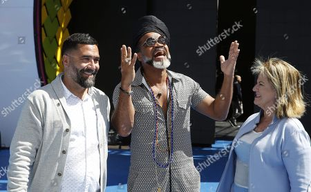 Brazilian singer, composer and producer Carlinhos Brown (C) poses next to Las Palmas de Gran Canaria's Carnival councilwoman Inmaculada Medina (R) and Carnival's Artistic Director Israel Reyes (L) at a presser held at Las Palmas de Gran Canaria, Canary Islands, Spain, 04 March 2019. This year's theme of the Las Palmas' Carnival is 'A night in Rio'.