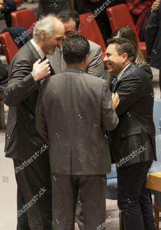 Syrian ambassador Bashar Jaafari (L) congratulates ambassador Samuel Moncada of Venezuela