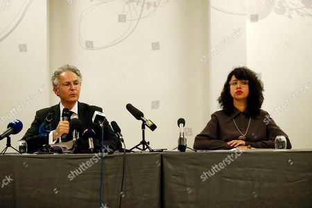 Jessica Finelle, right, and Francois Zimeray, lawyers of Carole, Caroline, Maya, Nadine and Anthony Ghosn, deliver a speech during a press conference in Paris, . The new lawyer of former Nissan chairman Carlos Ghosn says he believes the auto executive's latest request for release on bail from a Tokyo detention center might succeed