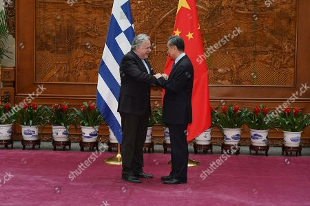Greek Foreign Minister George Katrougalos (L) shake hands with Chinese Foreign Minister Wang Yi (R) in Beijing, China, 04 March 2019.