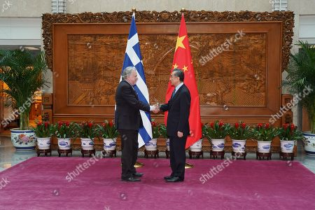 Editorial photo of Greek Foreign Minister George Katrougalos meets Chinese Foreign Minister Wang Yi, Beijing, China - 04 Mar 2019
