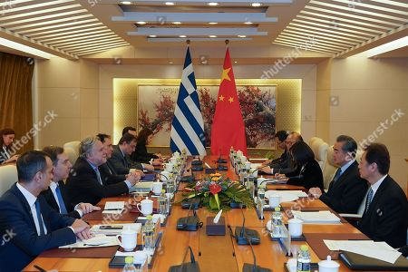 Greek Foreign Minister George Katrougalos (3-L) meets Chinese Foreign Minister Wang Yi (2-R) in Beijing, China, 04 March 2019.