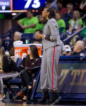 Virginia head coach Tina Thompson looks on during an NCAA college basketball game against Notre Dame, in South Bend, Ind. Notre Dame won 103-66