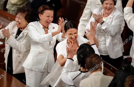 From, women members of the House of Representatives, including Rep. Alexandria Ocasio-Cortez, D-N.Y., center, cheer after President Donald Trump acknowledges more women in Congress during his State of the Union address to a joint session of Congress on Capitol Hill in Washington. From left are House Appropriations Committee Chair Nita Lowey, D-N.Y., House Small Business Committee Chair Nydia Velazquez, D-N.Y., Rep. Alexandria Ocasio-Cortez, D-N.Y., and Rep. Lois Frankel, D-Fla
