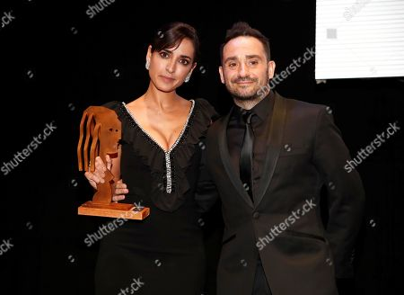 Inma Cuesta (L) poses after receiving the 'Best Cinema Actress' award on behalf of Penelope Cruz next to film director Juan Antonio Bayona (R) during the 69th Fotogramas Awarding ceremony in Madrid, Spain, 04 March 2019 (issued 05 March 2019).
