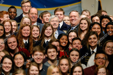Mike Pompeo, Terry Branstad. U.S. Ambassador to China Terry Branstad, center, and Secretary of State Mike Pompeo pose for a photo with Future Farmers of America and Johnston High School students, in Johnston, Iowa