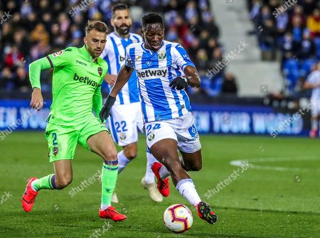 Leganes' defender Kenneth Omeruo (R) vies for the ball against Levante's forward Borja Mayoral (R) during the Spanish LaLiga soccer match between CD Leganes and Levante UD at Butarque stadium in Leganes, Madrid, Spain, 04 March 2019.