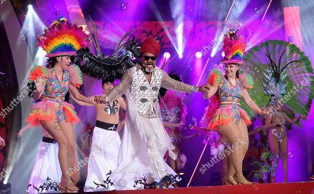 Brazilian musician and singer Carlinhos Brown (C) performs during the Drag Queen contest gala at Las Palmas 2019 Carnival in Las Palmas de Gran Canaria, Canary Islands, Spain, 04 March 2019.