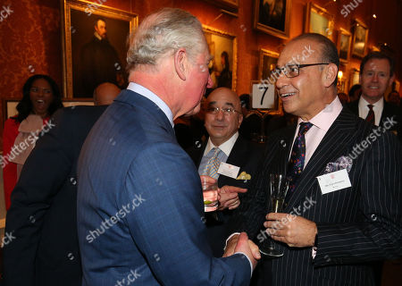Prince Charles speaks to Theo Paphitis during a reception at Buckingham Palace to celebrate the Cypriot diaspora in the UK.