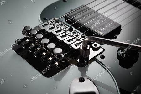 Detail Of A Floyd Rose Double-locking Vibrato On A Squier Contemporary Active Stratocaster Hh Electric Guitar With An Olympic White Finish