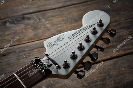 Detail Of The Headstock On A Squier Contemporary Active Stratocaster Hh Electric Guitar With An Olympic White Finish
