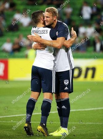 Ola Toivonen (R) of Melbourne celebrates with his teammate Kosta Barbarouses (L) after scoring the 1-0 lead during the AFC Champions League group F soccer match between Melbourne Victory and Daegu FC in Melbourne, Australia, 05 March 2019.