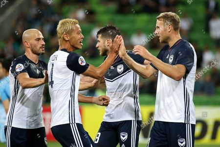 Ola Toivonen (R) of Melbourne celebrates with his teammate Keisuke Honda (2-L) after scoring the 1-0 lead during the AFC Champions League group F soccer match between Melbourne Victory and Daegu FC in Melbourne, Australia, 05 March 2019.