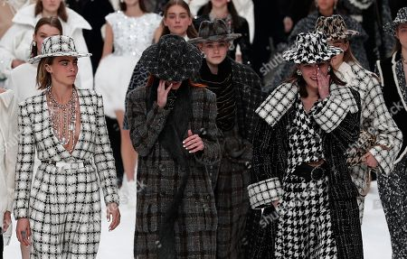 British model Cara Delevingne (L), Italian model Mariacarla Boscono (C) and crying models pay tribute to the late German designer Karl Lagerfeld after the presentation of the Fall/Winter 2019/20 Women's collection of Chanel fashion house during the Paris Fashion Week, in Paris, France, 05 March 2019. Karl Lagerfeld died aged 85 on 19 February 2019. His final collection for Chanel is presented at the Grand Palais on the last day of the Paris Fashion Week.