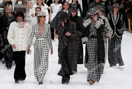 British model Cara Delevingne (2-L), Argentinia model Mica Arganaraz, Italian model Mariacarla Boscono (2-R) and crying models pay tribute to the late German designer Karl Lagerfeld after the presentation of the Fall/Winter 2019/20 Women's collection of Chanel fashion house during the Paris Fashion Week, in Paris, France, 05 March 2019. Karl Lagerfeld died aged 85 on 19 February 2019. His final collection for Chanel is presented at the Grand Palais on the last day of the Paris Fashion Week.