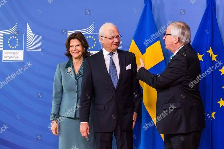 EU Commission President Jean-Claude Juncker, right, welcomes Sweden's King Carl Gustav and Queen Silvia upon their arrival at EU headquarters in Brussels