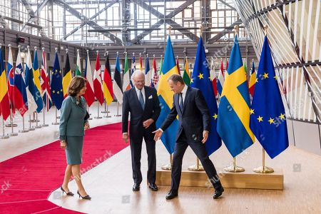 European Council President Donald Tusk, right, welcomes Sweden's King Carl Gustav, center, and Queen Silvia upon their arrival at the EU Council in Brussels