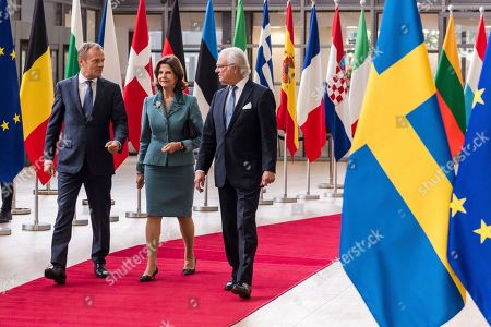 European Council President Donald Tusk, left, welcomes Sweden's King Carl Gustav, right, and Queen Silvia upon their arrival at the EU Council in Brussels