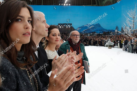 Alma Jodorowsky, Marion Cotillard. Actresses Alma Jodorowsky, left, and Marion Cotillard, second from right, applaud the Chanel ready to wear Fall-Winter 2019-2020 collection, that was presented in Paris