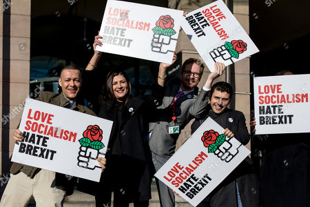 """Labour MP Clive Lewis (L) joins a group of Labour MPs and supporters outside Portcullis House for a """"Love Socialism, Hate Brexit"""" photocall."""