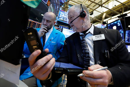 Meric Greenbaum, Robert Moran. Specialist Meric Greenbaum, left, and trader Robert Moran work on the floor of the New York Stock Exchange, . Stocks are opening slightly lower on Wall Street led by losses in banks and technology companies