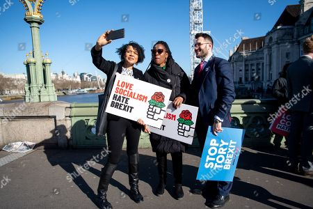 Stock Photo of From left to right MPs Chi Onwhtah (for Newcastle upon Tyne Central), Kate Osamor (for Edmonton), Paul Sweeney (for Glasgow North) film themselves themselves following a stunt on Westminster bridge.